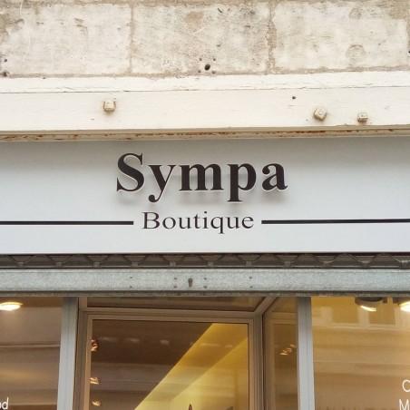 Sympa Boutique Enseigne PVC épaisseur 19 mm teinté sur face avant et chants brut