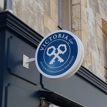Enseigne drapeau PVC ronde magasin Victoria Keys