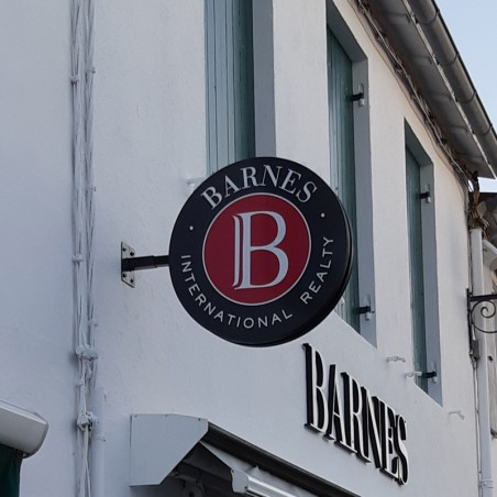Enseigne drapeau PVC ronde magasin Barnes